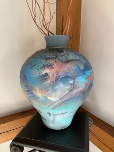 raku vase in blues, turquoise and coral